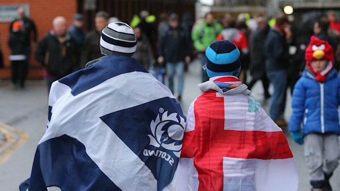 Rugby supporters are seen ahead of the Six Nations rugby union international match between Scotland and England at Murrayfield, Edinburgh, Scotland, Saturday Feb. 8, 2014. (AP Photo/Scott Heppell)