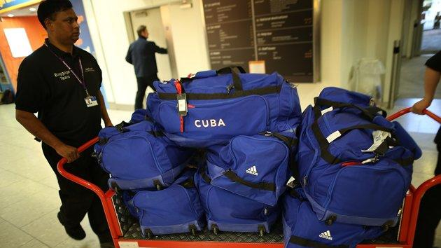 LONDON, ENGLAND - JULY 16: Baggage belonging to the Cuban Olympic weightlifting team is transported through Heathrow Airport on July 16, 2012 in London, England. Athletes, coaches and Olympic officials are beginning to arrive in London ahead of the Olympics. (Photo by Peter Macdiarmid/Getty Images)
