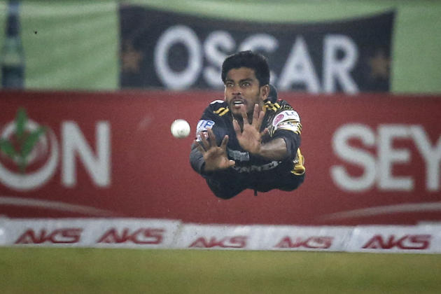 Hasan Miraz dives to make a catch