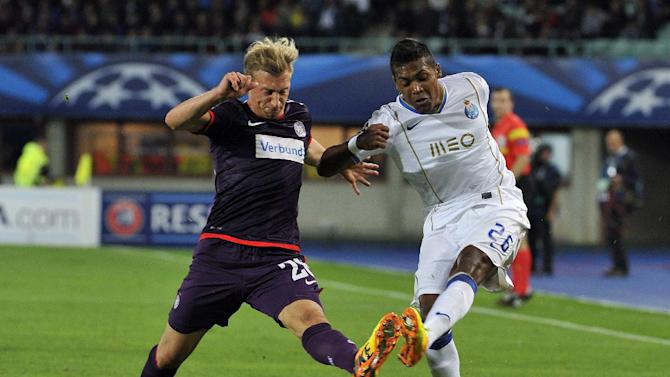 Austria's Daniel Royer, left, and Porto's Alex Sandro challenge for the ball during the Champions League first round group G soccer match between FK Austria Wien and FC Porto in Vienna, Austria, Wednesday, Sept. 18, 2013