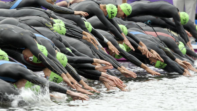 Athletes dive as they begin to compete in the men's triathlon final during the London 2012 Olympic Games at Hyde Park