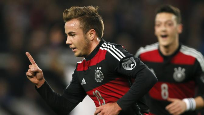 Germany's Goetze celebrates scoring a goal against Chile during their international friendly soccer match in Stuttgart