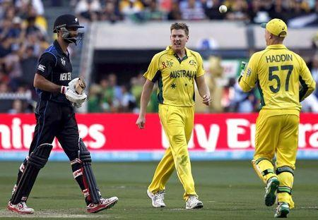 Australia's wicketkeeper Brad Haddin celebrates with team-mate James Faulkner after dismissing New Zealand's Grant Elliott for 83 runs during their Cricket World Cup final match at the MCG