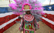 A member of the Cheyenne Mardi Gras Indian tribe readies to parade with the tribe at the New Orleans Jazz and Heritage Festival in New Orleans, Thursday, May 3, 2012. (AP Photo/Gerald Herbert)