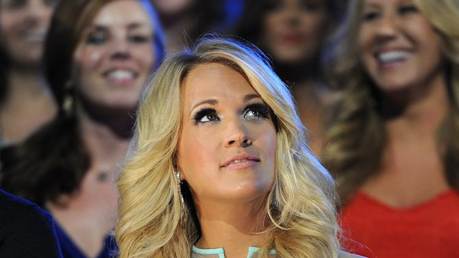 Carrie Underwood appears in the audience at the 2013 CMT Music Awards at Bridgestone Arena on Wednesday, June 5, 2013, in Nashville, Tenn. (Photo by Frank Micelotta/Invision/AP)