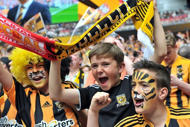 Young Hull City fans cheer before the start of the English FA Cup final match between Arsenal and Hull City at Wembly Stadium in London on May 17, 2014