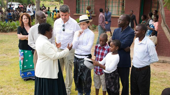 US performer Madonna, centre,  visits the Mphandura orpahange near Lilongwe, Malawi Friday April 5, 2013.  Madonna, is spending her fourth day in the southern African country from where she adopted two children. (AP Photo/Thoko Chikondi)