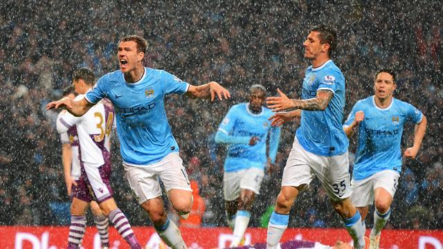 Premier League - Man City beat Villa to put one hand on title