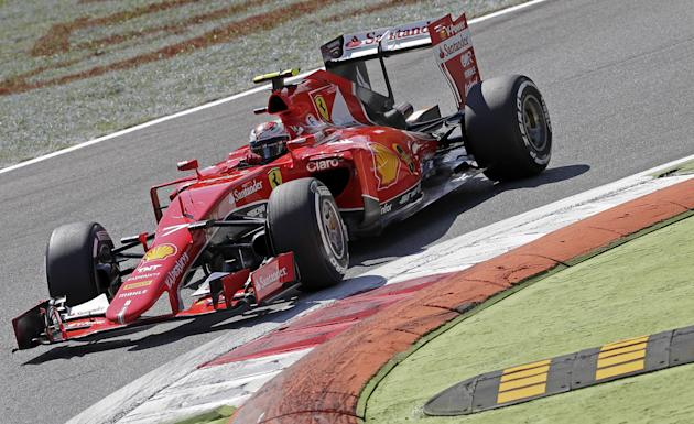 Ferrari Formula One driver Raikkonen of Finland takes a corner on his way to getting second position during the qualifying round for the Italian F1 Grand Prix in Monza