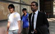 Yong Yun Leong (left) and Yong Yun Chung (centre), the brothers of convicted Malaysian drug trafficker Yong Vui Kong, leave the High Court with lawyer M Ravi, in Singapore on April 4, 2011. Yong Vui Kong, on death row for drug trafficking had what could be his final appeal thrown out on Wednesday by the city-state's highest court.