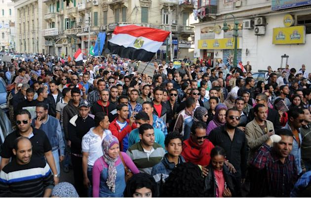 Egyptians take part in a protest against a power grab by President Mohamed Morsi.