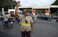 A security officer guards the military hospital in Caracas where Venezuelan President Hugo Chavez has been hospitalized on February 18, 2013