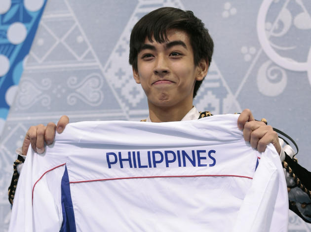Michael Christian Martinez of the Philippines holds up a jacket after the men's short program figure skating competition at the Iceberg Skating Palace during the 2014 Winter Olympics, Thursday, Feb. 13, 2014, in Sochi, Russia. (AP Photo/Ivan Sekretarev)