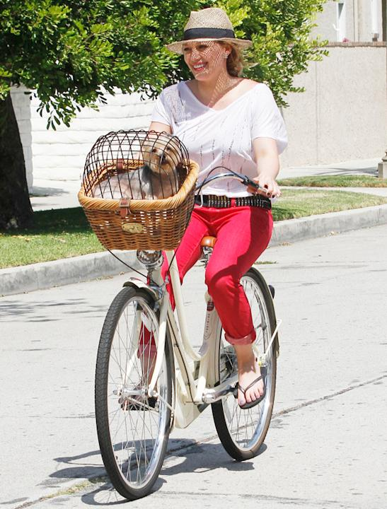 Celebrity pets: Hilary Duff is all smiles as she goes for a bike ride with her loveable pet…