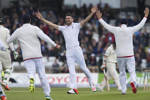 England's James Anderson, centre, celebrates his 400th test wicket after taking the wicket of New Zealand's Martin Guptill, caught by Ian Bell for 0, on the first day of the second Test match