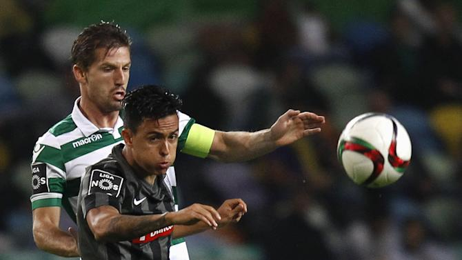 Sporting's Adrien Silva for the ball with Guimaraes' Montoya during their Portuguese Premier League soccer match in Lisbon