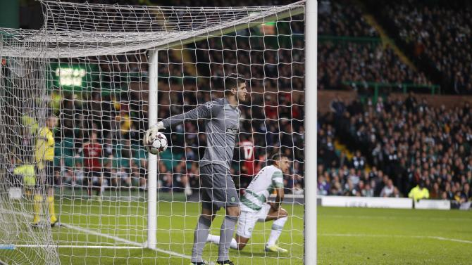 Celtic's Forster retrieves the ball after conceding a goal against AC Milan during their Champions League soccer match in Glasgow