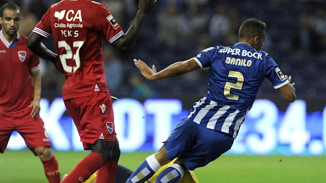 FC Porto's Danilo Silva, right, fails to score past Gil Vicente's goalkeeper Adriano Facchini, both from Brazil, in a Portuguese League soccer match at the Dragao stadium in Porto, Portugal, Saturday, Sept. 14, 2013. Porto won 2-0