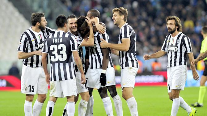 Juventus midfielder Paul Pogba, center, of France, celebrates with teammates after scoring  during a Serie A soccer match between Juventus and Napoli at the Juventus stadium, in Turin, Italy, Sunday, Nov. 10, 2013