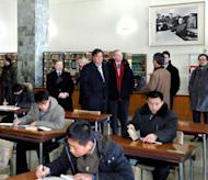 "Bill Richardson (C-R) and Eric Schmidt (C-L) at the Grand People's Study House in Pyongyang on Wednesday. Schmidt is part of a ""private humanitarian mission"" to North Korea led by former New Mexico governor Richardson, which is ostensibly focused on the case of a detained US citizen awaiting trial for alleged crimes against the state"