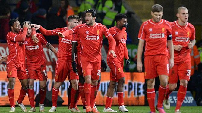 Liverpool's players celebrate after scoring a goal during a FA Cup match at the Reebok Stadium in Bolton, on February 4, 2015
