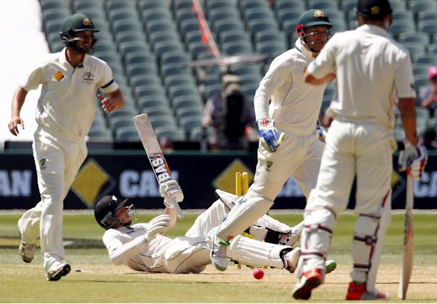 New Zealand's Mitchell Santner lies on the pitch after being stumped by Australia's wicketkeeper Peter Nevill for 45 runs during the third day of the third cricket test match at the Adelaide O