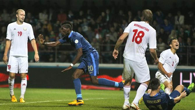 France's Paul Pogba, second left, celebrates after scoring during their World Cup Group I qualifying soccer match against Belarus in Gomel, Belarus, Tuesday, Sept. 10, 2013