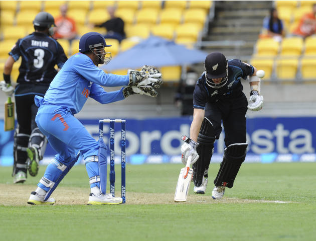 New Zealand's Kane Williamson, right, makes his ground as the ball is returned to India's wicketkeeper MS Dhoni in the fifth and final one-day international cricket match in Wellington, New Zealan