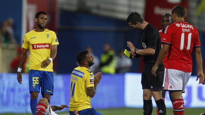 Estoril's Galvao reacts after committing a foul on Benfica's Pereira during their Portuguese Premier League soccer match in Estoril
