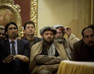 Afghan men follow a speech by presidential candidate and former foreign minister Zalmai Rassoul during a meeting with supporters in Kabul, Afghanistan, Wednesday, March 26, 2014. The race for Afghanistan's next president narrows to eight with the withdrawal of Mohammad Nadir Naim, a presidential candidate with royal lineage. (AP Photo/Anja Niedringhaus)