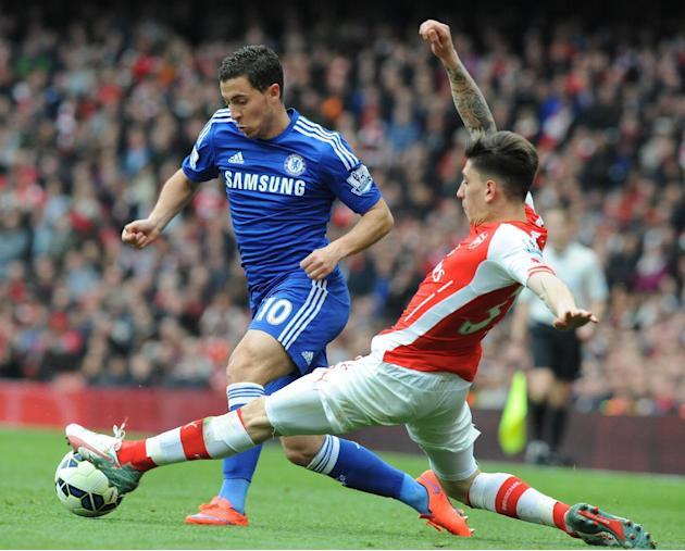Arsenal's Hector Bellerin, right, tackles Chelsea's Eden Hazard during the English Premier League soccer match between Arsenal and Chelsea at the Emirates Stadium, London, England, Sunday, Apr