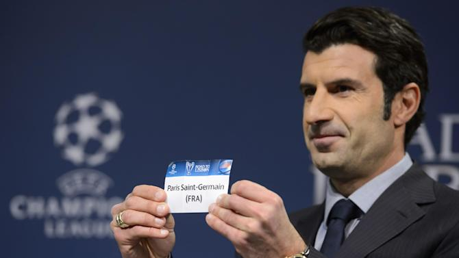 Former Portugal national soccer player and Champions League Lisbon final ambassador Luis Figo shows a ticket with France's soccer team Paris Saint-Germain during the draw of the round of 16 games of UEFA Champions League 2013/14 at the UEFA Headquarters in Nyon, Switzerland, Monday, Dec. 16, 2013