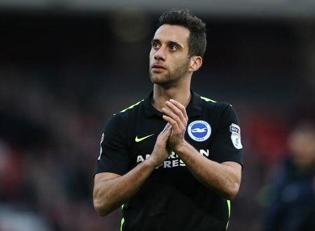 Sam Baldock of Brighton & Hove Albion applauds the fans at the end of the game