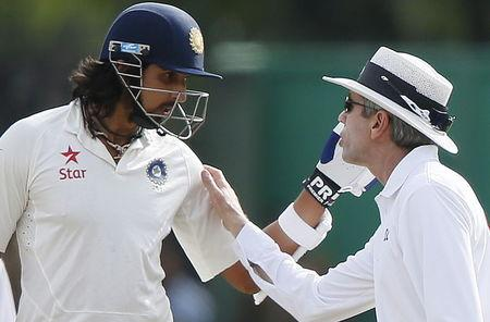 Umpire Llong speaks with India's Sharma after an argument between Sharma and Sri Lanka's bowler Prasad during the fourth day of their third and final test cricket match in Colombo