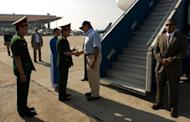 US Secretary of Defense Leon Panetta (centre) is greeted by Vietnamese officials as he arrives at Noi Bai International Airport in Hanoi. Panetta said a former port used by US forces in the Vietnam War could play a pivotal role in the American military's shift towards the Asia-Pacific