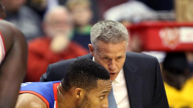 Philadelphia 76ers' Brett Brown, right talks to Evan Turner as they play the Chicago Bulls in the first half of an NBA basketball game Saturday, Nov. 2, 2013, in Philadelphia