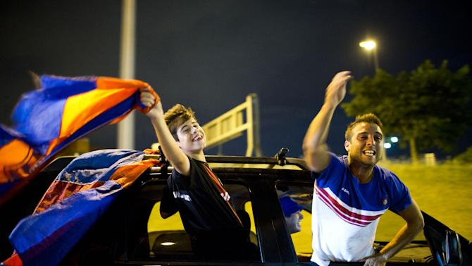 San Lorenzo's fans celebrate after their team won Argentina's soccer league championship against Velez Sarsfield in Buenos Aires, Argentina,  Sunday, Dec. 15, 2013