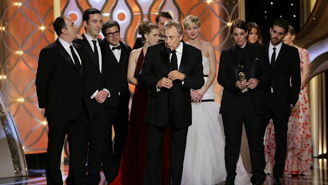 "This image released by NBC shows Charles Roven, center, accepting the award for best motion picture comedy for ""American Hustle"" during the 71st annual Golden Globe Awards at the Beverly Hilton Hotel on Sunday, Jan. 12, 2014, in Beverly Hills, Calif. (AP Photo/NBC, Paul Drinkwater)"