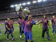 Barcelona's Adriano Correia lifts the Cup as he celebrates his team's Spanish Cup victory on May 25. Barcelona defeated Athletic Bilbao 3-0