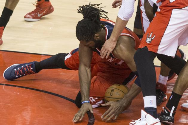 Washington Wizards' Nene Hilario gathers up a loose ball against the Tornto Raptos during the first half in Game 1 of the NBA basketball playoffs in Toronto, Saturday, April 18, 2015. (Chris Young
