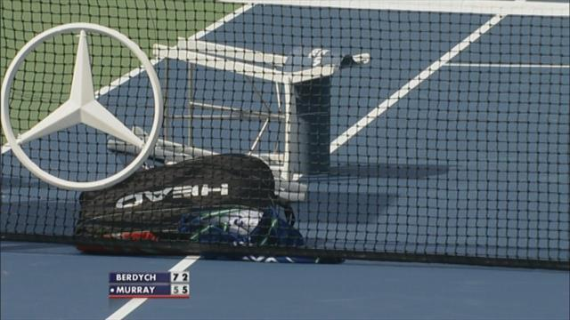 Wind blows chairs on court during US Open semi