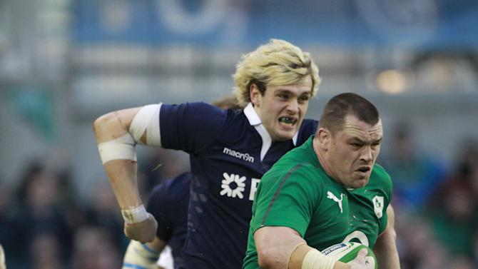 Ireland's Cian Healy, right, breaks away from Scotland's Richie Gray during their Six Nations Rugby Union international match at the Aviva Stadium, Dublin, Ireland, Sunday, Feb. 2, 2014. (AP Photo / Peter Morrison)