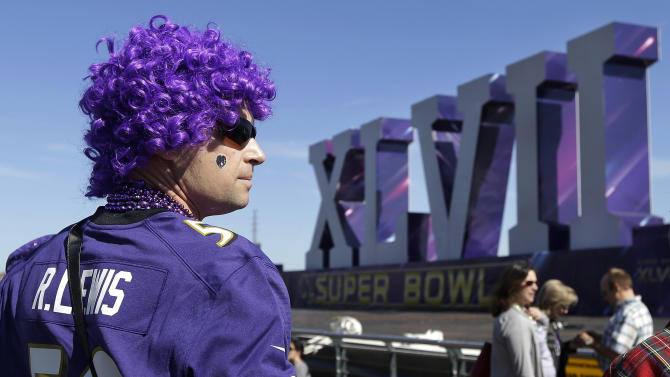 Baltimore Ravens fan Cal Wheaton looks out toward the Super Bowl XLVII sculpture on a barge along the Riverwalk in New Orleans, Sunday, Feb. 3, 2013. The city hosts NFL football's Super Bowl XLVII between the San Francisco 49ers and Baltimore Ravens on Sunday. (AP Photo/Jeff Chiu)