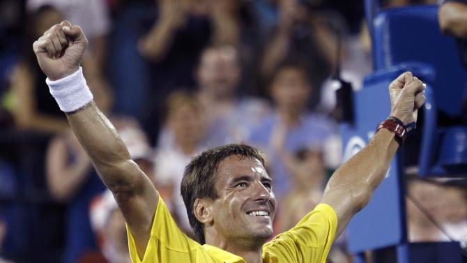 Robredo of Spain celebrates after defeating Federer of Switzerland at the U.S. Open tennis championships in New York