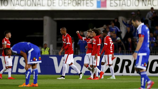 Players of Brazil's Internacional celebrate a goal against Universidad de Chile during their Copa Libertadores soccer match in Santiago