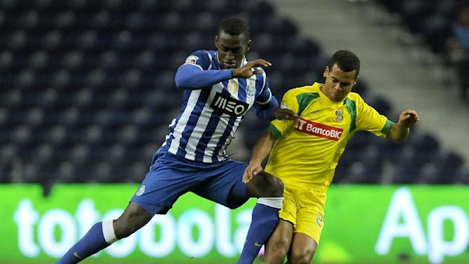 FC Porto's Jackson Martinez, left, from Colombia challenges Pacos Ferreira's Rodrigo Antonio, from Brazil, in a Portuguese League soccer match at the Dragao stadium in Porto, Portugal, Sunday, Feb. 9, 2014. Jackson scored once in Porto's 3-0 victory