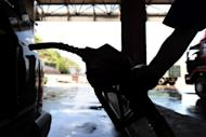 World oil prices got a bump Monday from Greece's approval of austerity measures, which have been demanded by international creditors in return for a second bailout, analysts said
