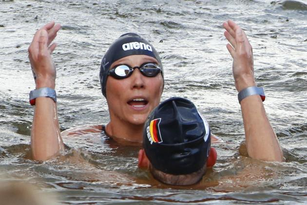 German swimmers react after winning the gold medal in the open water 5km team event at the 16th FINA World Championships in Kazan