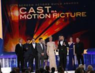 "Actor Bradley Cooper accepts the award for Outstanding Performance by a Cast in a Motion Picture for ""American Hustle"" at the 20th annual Screen Actors Guild Awards in Los Angeles, California January 18, 2014. REUTERS/Mike Blake"