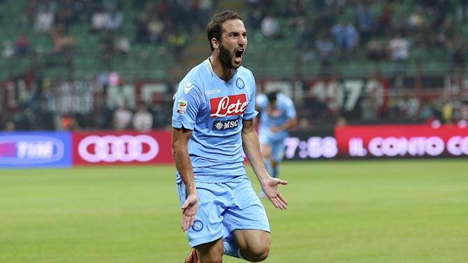 Napoli forward Gonzalo Higuain, of Argentina, celebrates after scoring his side's second goal, during the Serie A soccer match between AC Milan and Napoli at the San Siro stadium in Milan, Italy, Sunday, Sept. 22, 2013